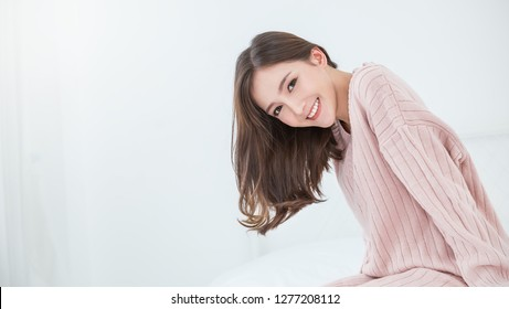 Portrait smile happy beautiful innocence asian woman relax bedroom. Asian girl face winter cloth. Beauty long hair woman treatment perfect clear cosmetology skin Japanese girl makeup hygge lifestyle