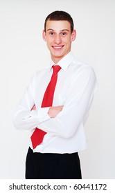 portrait of smiley businessman with red necktie