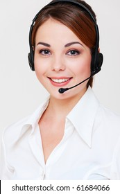portrait of smiley telephone operator over grey background