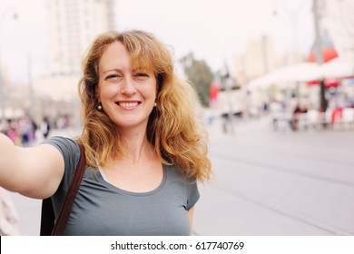 Portrait of smiling 40 years old woman outdoors