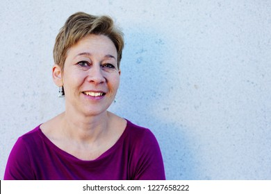 Portrait of smiling 45 years old woman outdoors