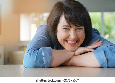 Portrait of smiling 50-year-old woman