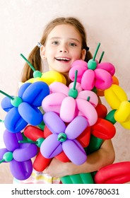 Portrait of smiling adorable little girl child with balloons happy birthday