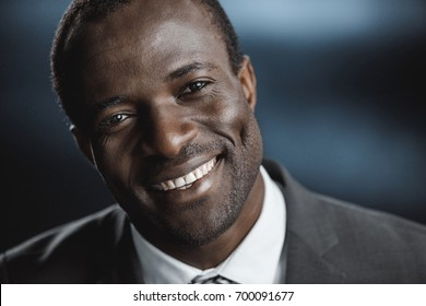portrait of smiling african american businessman looking at camera