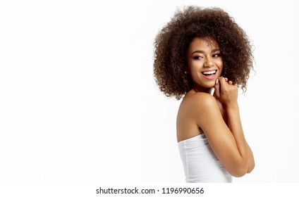 Portrait of smiling african american woman looking on empty space isolated on white background