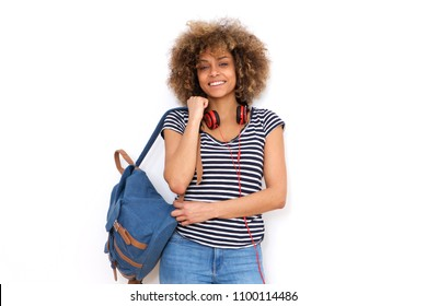 Portrait of smiling african american young woman with bag against white background
