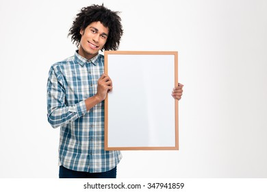 Portrait of a smiling afro american man holding blank board isolated on a white background