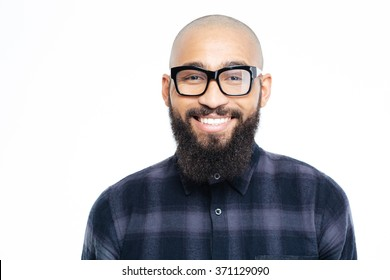 Portrait of a smiling afro american man looking at camera isolated on a white background
