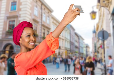 Portrait of a smiling afro american woman making selfie photo