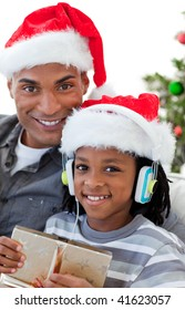 Portrait of a smiling Afro-American father and son at Christmas time