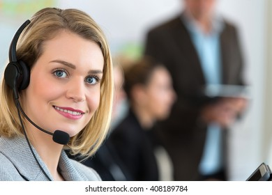 Portrait of smiling agent woman with headsets