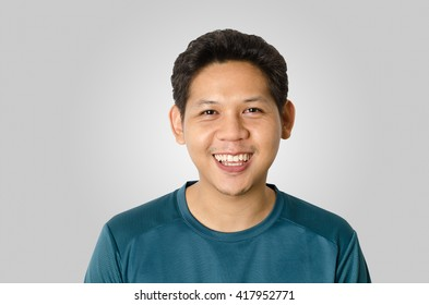 Portrait of smiling asia man isolated on gray background