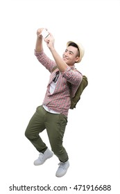 Portrait of smiling asian man taking selfie on white background with backpack taking a photo