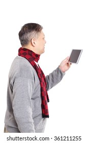 portrait smiling Asian old man in sweater and scarf with tablet