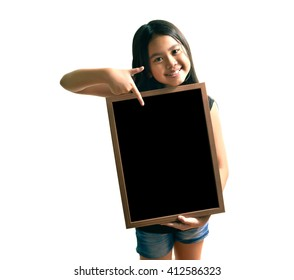 Portrait of smiling asian  pretty girl holding black board on white background isolated white at the studio.