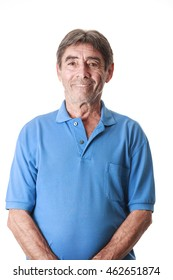 Portrait of a smiling attractive senior man looking directly at the camera with white background