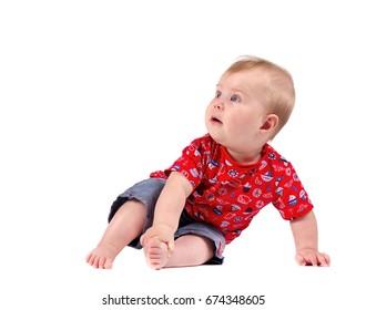Portrait of smiling baby boy isolated on white background.