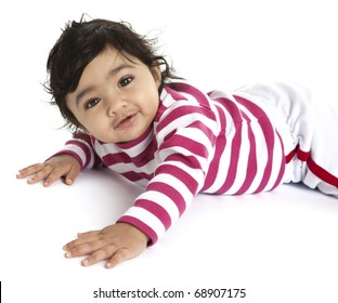 Portrait of a Smiling Baby Girl on Her Tummy, Isolated, White