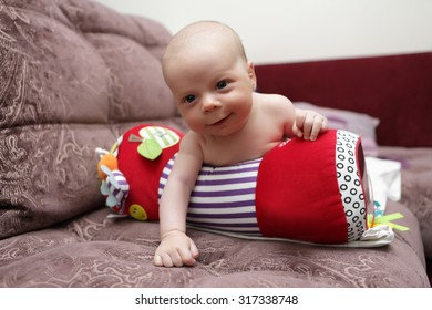 Portrait of smiling baby on crawling roll