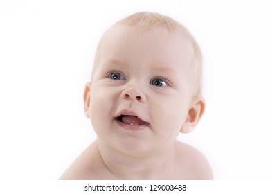 portrait of a smiling baby on a white background.