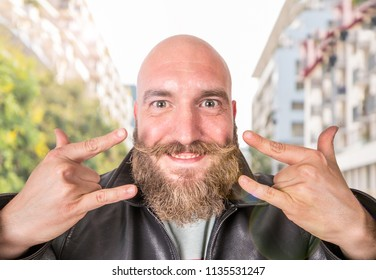 portrait of smiling bearded man