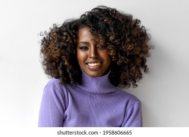 Portrait of smiling beautiful black girl wear turtleneck with afro hairstyle
