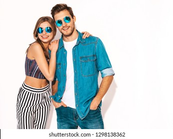 Portrait of Smiling Beautiful Girl and her Handsome Boyfriend laughing.Happy Cheerful Family in sunglasses.Valentine's Day. Isolated on white. Hugging