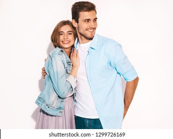 Portrait of Smiling Beautiful Girl and her Handsome Boyfriend laughing.Happy Cheerful Family.Valentine's Day. Isolated on white. Hugging