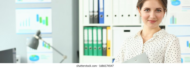 Portrait of smiling beautiful lady in modern meeting room. Businesswoman visiting business negotiation in international firm. Biz company concept. Blurred background