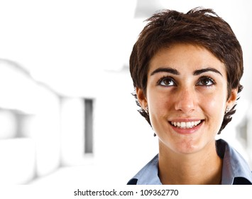 Portrait of a smiling beautiful woman looking up