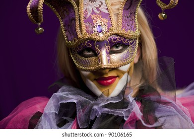 Portrait of smiling beauty woman in venetian mask