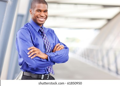 A portrait of a smiling black businessman outdoor