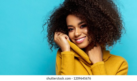 Portrait of smiling black woman with afro hairstyle