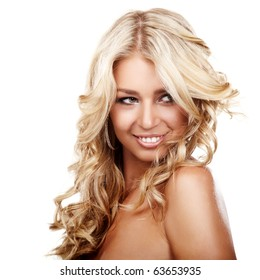 Portrait of a smiling blond lady with a beautiful hair isolated on white