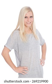 Portrait of Smiling Blond Woman Wearing Grey T-Shirt with Hands on Hips Standing in Studio with White Background