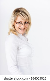 Portrait of a smiling blonde girl with glasses