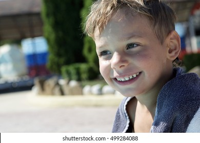 Portrait of smiling boy after swimming in pool