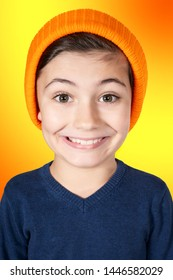 portrait of smiling boy with big head and orange background