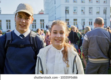 Portrait of smiling boy and girl on schoolyard.