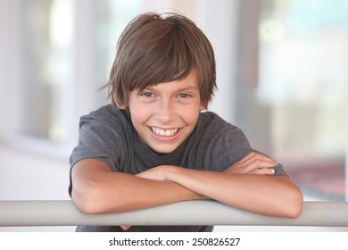 portrait of a smiling boy outdoors