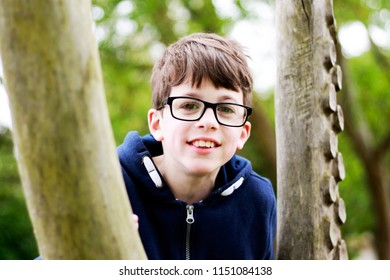 Portrait of a smiling boy in the woods