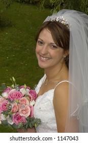 Portrait of smiling bride, UK.