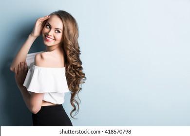 Portrait of a smiling brunette woman.