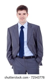 Portrait of a smiling business man standing with his hands in the pockets
