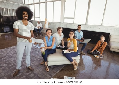 Portrait of smiling business people in creative office