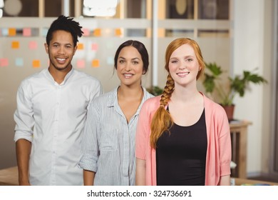 Portrait of smiling business people standing in office