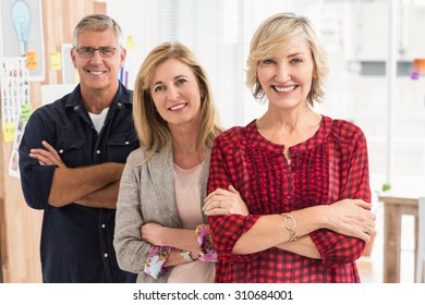 Portrait of a smiling business team in a row at office