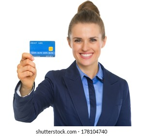 Portrait of smiling business woman showing credit card