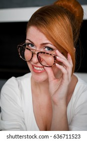 Portrait of a smiling business woman wearing glasses