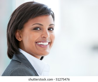 Portrait of a smiling business woman at work in her office